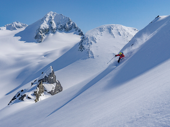 Skier on untouched powder in high alpine